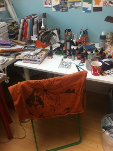 my messy worktable and fabulous apron- thrifted- it's an inuit screen print!